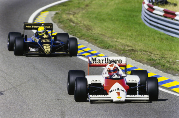 Niki Lauda, McLaren MP4-2B TAG, leads Ayrton Senna, Lotus 97T Renault.