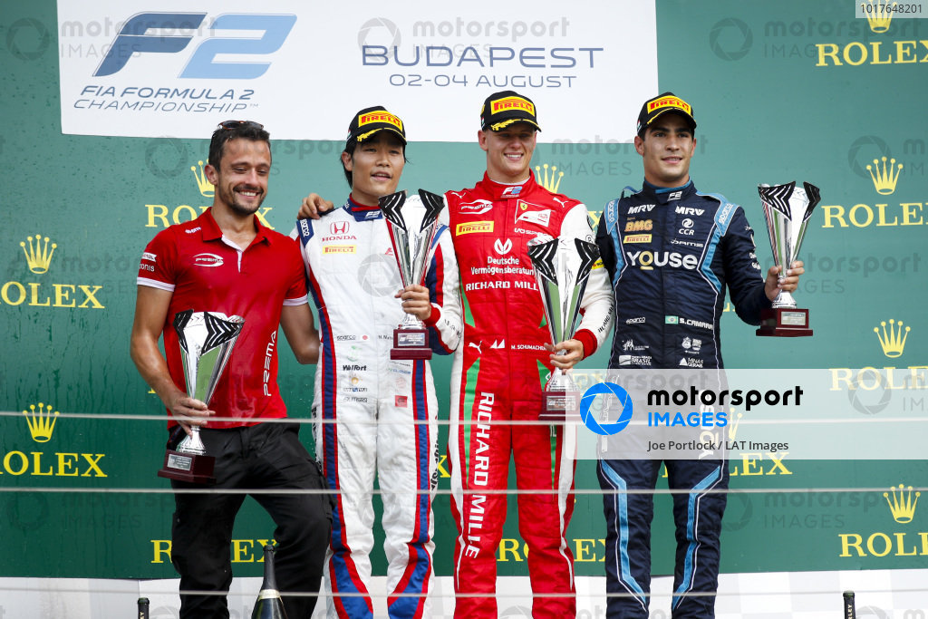 HUNGARORING, HUNGARY - AUGUST 04: Nobuharu Matsushita (JPN, CARLIN), Race winner Mick Schumacher (DEU, PREMA RACING) and Sergio Sette Camara (BRA, DAMS) on the podium with the trophy during the Hungaroring at Hungaroring on August 04, 2019 in Hungaroring, Hungary. (Photo by Joe Portlock / LAT Images / FIA F2 Championship)
