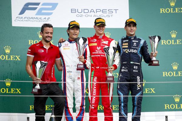 HUNGARORING, HUNGARY - AUGUST 04: Nobuharu Matsushita (JPN, CARLIN), Race winner Mick Schumacher (DEU, PREMA RACING) and Sergio Sette Camara (BRA, DAMS) on the podium with the trophy during the Hungaroring at Hungaroring on August 04, 2019 in Hungaroring, Hungary. (Photo by Joe Portlock / LAT Images / FIA F2 Championship)