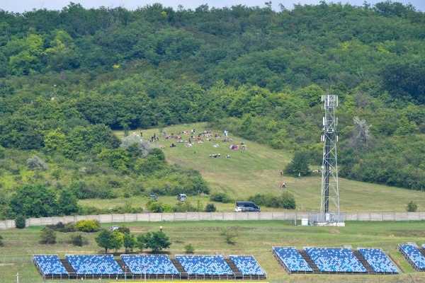 Fans congregate in the hills to gain a vantage point over the circuit