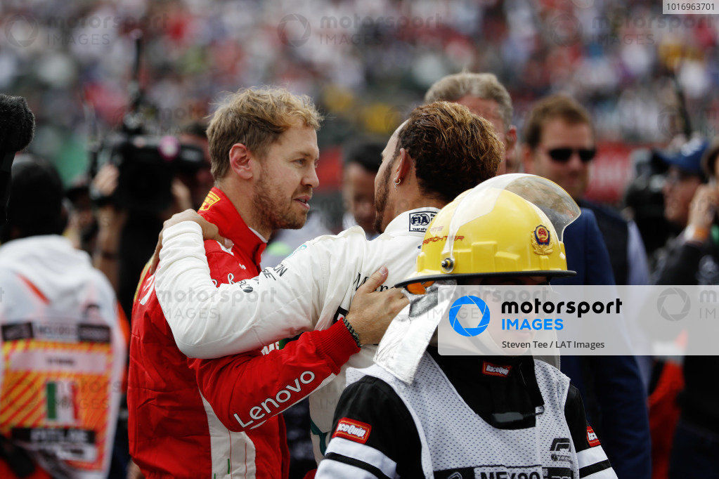 Sebastian Vettel, Ferrari, congratulates World Champion Lewis Hamilton, Mercedes AMG F1, in Parc Ferme