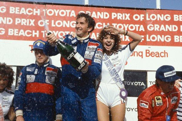 1983 United States Grand Prix West.Long Beach, California, USA.25-27 March 1983.John Watson (McLaren Ford) 1st position, Niki Lauda (McLaren Ford) 2nd position and Rene Arnoux (Ferrari) 3rd position on the podium.Ref-83 LB 02.World Copyright - LAT Photographic