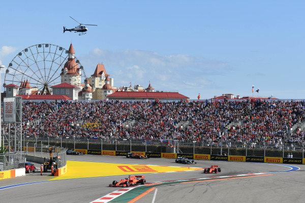 Sebastian Vettel, Ferrari SF90, leads Charles Leclerc, Ferrari SF90, and Lewis Hamilton, Mercedes AMG F1 W10