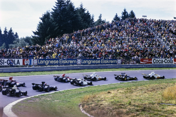 Peter Revson, McLaren M23 Ford leads Carlos Pace, Surtees TS14A Ford, teammate Denny Hulme, McLaren M23 Ford, Wilson Fittipaldi, Brabham BT42 Ford, Jean-Pierre Beltoise, BRM P160E, Emerson Fittipaldi, Lotus 72 Ford, and Clay Regazzoni, BRM P160E.