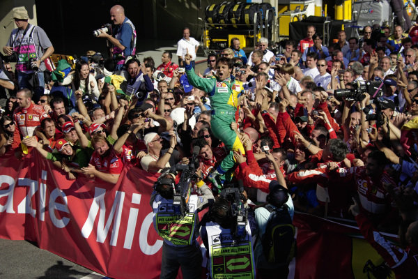 Felipe Massa celebrates victory with his team and family in parc fermé.