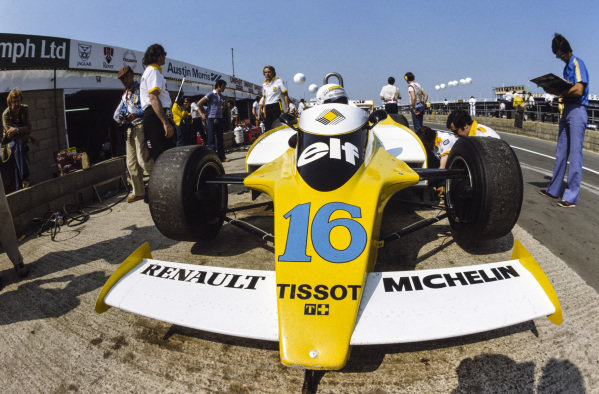 René Arnoux waits in the pits in his Renault RS10. Gerard Larrousse stands behind the car.