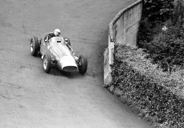 1954 German Grand Prix.Nurburgring, Germany. 30/7-1/8 1954.Stirling Moss (Maserati 250F) at Adenau Bridge. Ref-70-216 #27.World Copyright - LAT Photographic