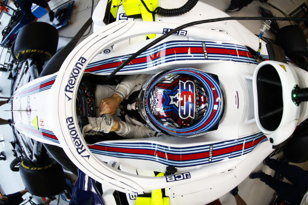 Sergey Sirotkin, Williams Racing, adjusts his gloves in cockpit.