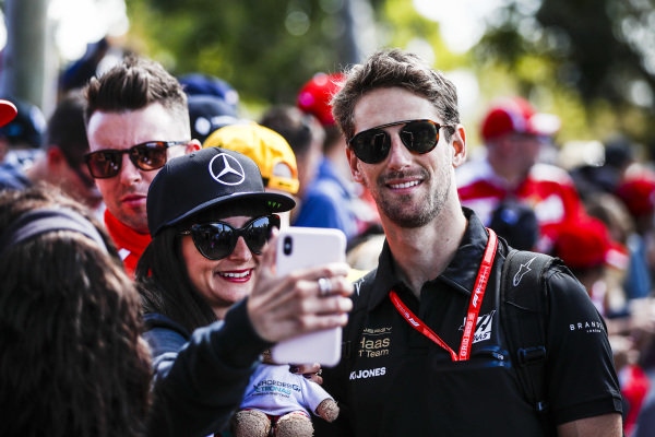 Romain Grosjean, Haas F1 Team poses for a selfie with a fan.
