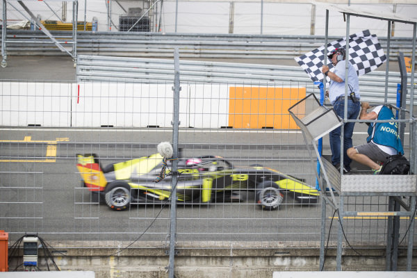 Marta Garcia (ESP) takes the chequered flag to win the race