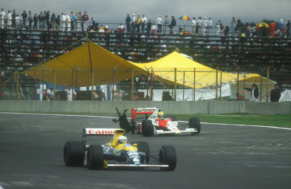 1990 Mexican Grand Prix.Mexico City, Mexico.8-10 June 1990.Ayrton Senna (McLaren MP4/5B Honda) retires on lap 64 as his punctured rear right tyre completely disintergrates. He had lead from the second lap and totally dominated the race until the puncture slowed him, dropping him down to third behind the Ferraris on lap 61. Here Riccardo Patrese (Williams FW13B Renault) passes.Ref-90 MEX 07.World Copyright - LAT Photographic