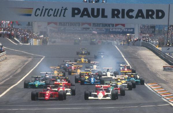 1990 French Grand Prix.Paul Ricard, Le Castellet, France.6-8 July 1990.Nigel Mansell (Ferrari 641) leads Gerhard Berger, Ayrton Senna (both McLaren MP4/5B Honda's), Alessandro Nannini (Benetton B190 Ford), Alain Prost (Ferrari 641), Riccardo Patrese (Williams FW13B Renault) and Ivan Capelli (Leyton House CG901 Judd) at the start. Ref-90 FRA 05.World Copyright - LAT Photographic