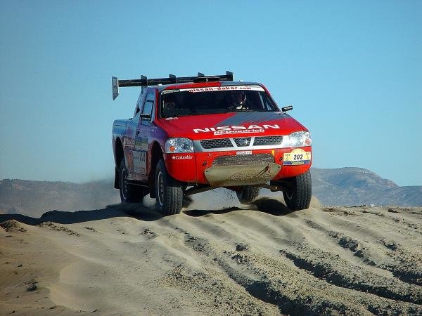 Colin McRae (GBR) / Tina Thorner (SWE) Nissan.