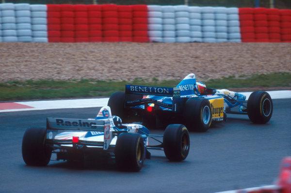 Nurburgring, Germany.29/9-1/10 1995.Michael Schumacher (Benetton B195 Renault) leads Damon Hill (Williams FW17B Renault).Ref-95 EUR 04.World Copyright - LAT Photographic
