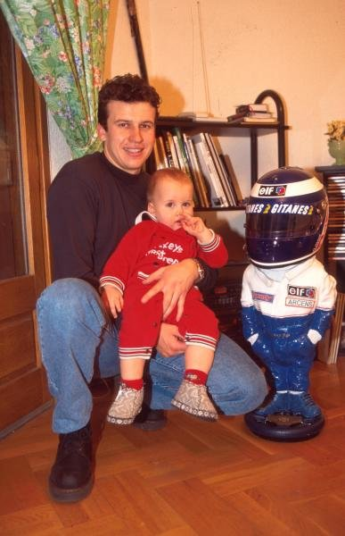 Olivier Panis at home with his baby