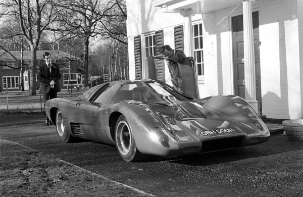 Bruce Mclaren with the Mclaren M6GT road car outside his house in Surrey, England, early in 1970