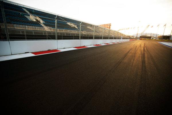 Sochi Autodrom, Sochi, Russia. Sunday 12 October 2014. The sun sets on the track. World Copyright: Charles Coates/LAT Photographic. ref: Digital Image _N7T7190