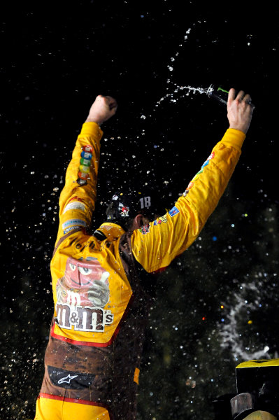 30 August - 1 September 2013, Hampton, Georgia, USA Kyle Busch, M&M's Toyota Camry celebrates his win in Victory Lane © 2013, Nigel Kinrade LAT Photo USA