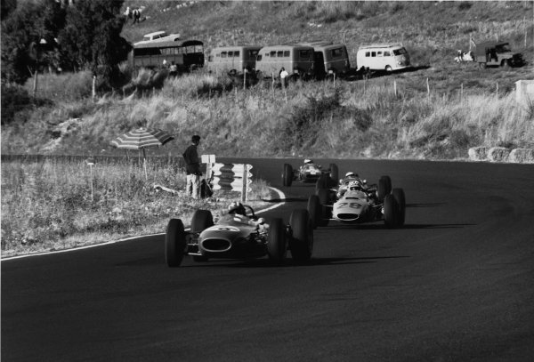 Enna-Pergusa, Sicily, Italy. 16th August 1964.Jo Siffert, Brabham-BRM, 1st position, leads Innes Ireland, BRP-BRM, 3rd position, action. Ref: 909 - 4World Copyright: LAT Photographic