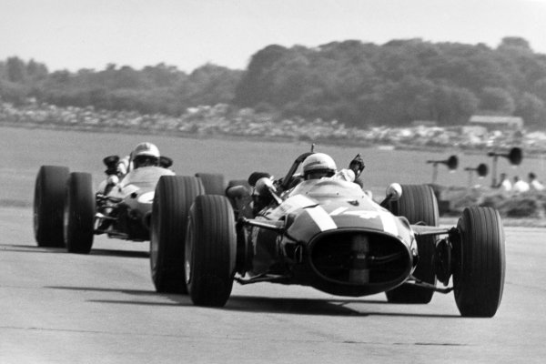 1967 British Grand Prix.Silverstone, Great Britain. 15 July 1967.Alan Rees, Cooper T81-Maserati, 9th position, leads Jack Brabham, Brabham BT24-Repco, 4th position, action.World Copyright: LAT PhotographicRef: Motor b&w print