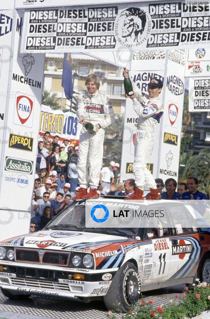 1990 World Rally Championship.Sanremo Rally, Italy. 14-18 October 1990.Didier Auriol/Bernard Occelli (Lancia Delta Integrale 16V), 1st position. Podium.World Copyright: LAT PhotographicRef: 35mm transparency 90RALLY14