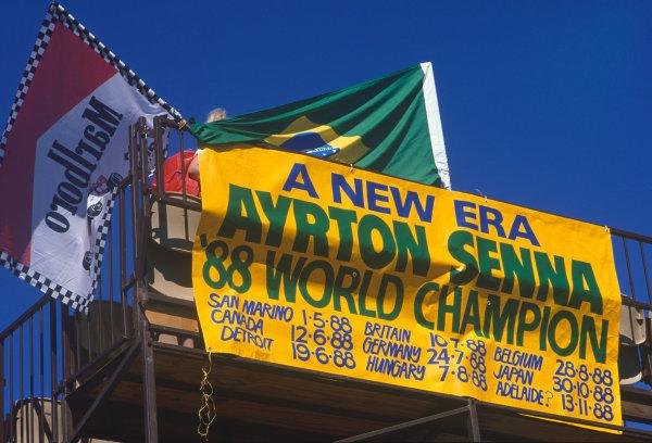 Adelaide, Australia.11-13 November 1988.Ayrton Senna Word Champion banner, fans, atmosphere.World Copyright: LAT Photographic.Ref:  Colour Transparency.