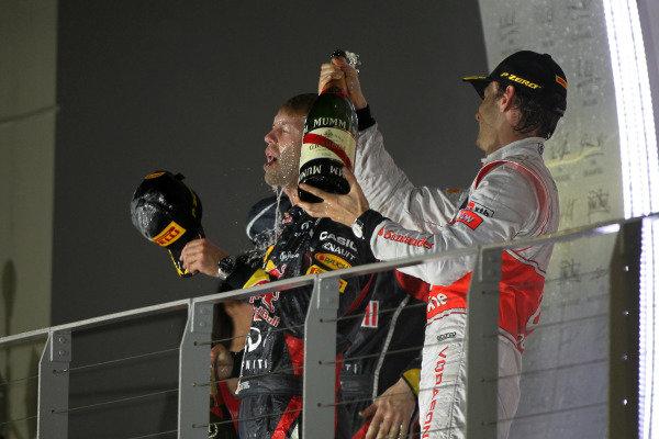 Marina Bay Circuit, Singapore23rd September 2012Sebastian Vettel, Red Bull Racing, 1st position, and Jenson Button, McLaren, 2nd position, celebrate on the podium.World Copyright: Andy Hone/LAT Photographicref: Digital Image HONY9561