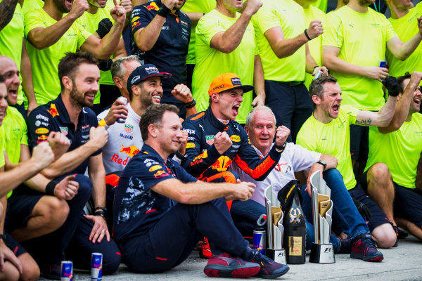 Sepang International Circuit, Sepang, Malaysia. Sunday 1 October 2017. Daniel Ricciardo, Red Bull Racing, 3rd Position, Helmut Markko, Consultant, Red Bull Racing, Max Verstappen, Red Bull, 1st Position, Christian Horner, Team Principal, Red Bull Racing, and the Red Bull Racing team celebrate. World Copyright: Glenn Dunbar/LAT Images  ref: Digital Image _X0W9268