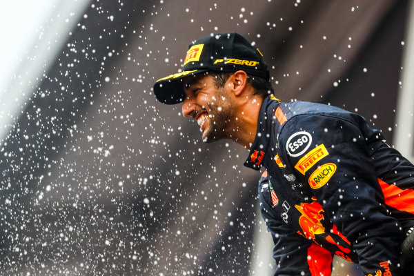 Spa Francorchamps, Belgium.  Sunday 27 August 2017. Daniel Ricciardo, Red Bull Racing, 3rd Position, sprays Champagne on the podium. World Copyright: Steven Tee/LAT Images  ref: Digital Image _O3I3358