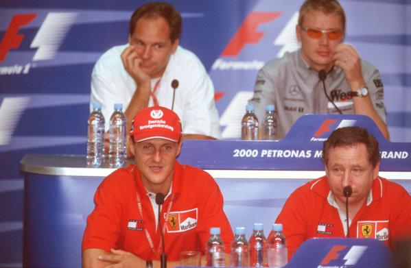 Sepang, Kuala Lumpur, Malaysia.20-22 October 2000.BMW Motorsport Director Gerhard Berger, Mika Hakkinen (McLaren Mercedes), Michael Schumacher (Ferrari) and Ferrari Team Principal Jean Todt at a press conference.Ref-35mm A67.World Copyright - Coates/LAT Photographic
