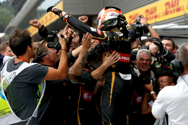Spa-Francorchamps, Spa, Belgium. Sunday 23 August 2015. Romain Grosjean, Lotus F1, 3rd Position, celebrates with his team in Parc Ferme. World Copyright: Glenn Dunbar/LAT Photographic ref: Digital Image _89P4907