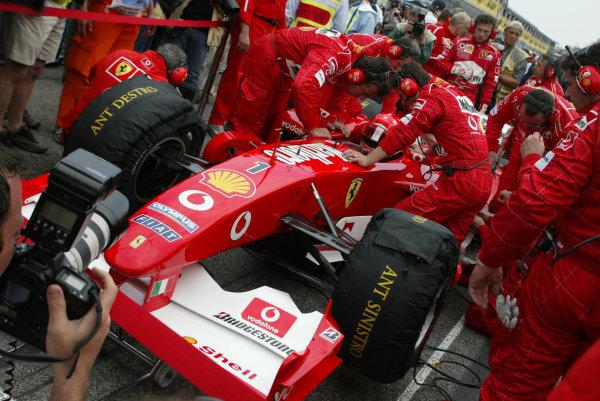 2003 San Marino Grand Prix - Sunday Race,Imola, Italy.20th April 2003.Michael Schumacher, Ferrari F2002, on the grid.World Copyright LAT Photographic.ref: Digital Image Only.