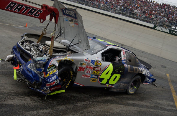04-06 June, 2004, Dover International Speedway, USA,Jimmie Johnsons wrecked machine gets towed into the garage,Copyright-Robt LeSieur 2004 USALAT Photographic