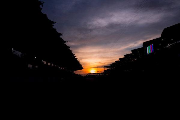 Sepang International Circuit, Sepang, Malaysia. Friday 29 September 2017. Sun rises at the Sepang Circuit. World Copyright: Zak Mauger/LAT Images  ref: Digital Image _56I2061