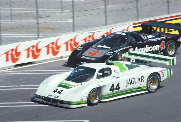 Miami, Florida, USA. 1st March 1987. RD 2. Hurley Haywood / John Morton (Jaguar XJR-7), 10th position, leads Pete Halsmer / Scott Pruett (Ford Mustang GTP), 3rd position, action.World Copyright: Murenbeeld/LAT Photographic. Ref: 87IMSA MIA01.