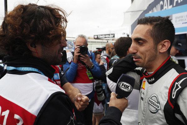 Sébastien Buemi (CHE), Nissan e.Dams, Nissan IMO1, talks to the media
