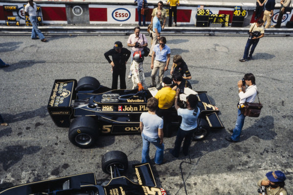 Mario Andretti waits to get into his Lotus 79 Ford in the pitlane.