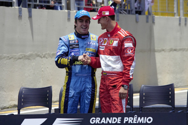 Handshake between title rivals Michael Schumacher and Fernando Alonso for the media.