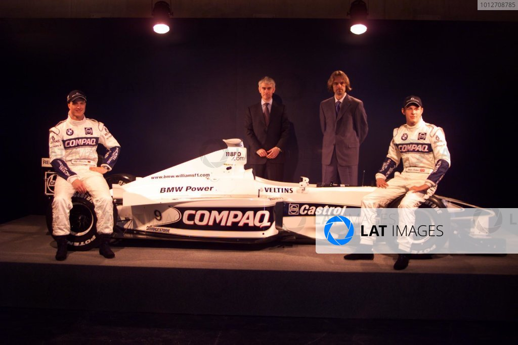 BMW Williams F1 Team Launch 2000.Barcelona, Spain. 24th January 2000.Ralf Schumacher and Jenson Button, with the designers of the car at the launch of the WilliamsF1 BMW FW22.World - LAT Photographic.email: digital@latphoto.co uk