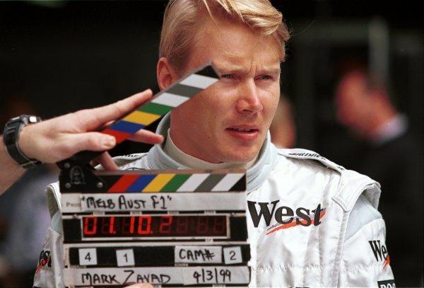 1999 Australian Grand Prix.Albert Park, Melbourne, Australia. 4th March 1999.Mika Hakkinen (McLaren Mercedes-Benz) is filmed in the paddock.World Copyright - Etherington/LAT Photographic