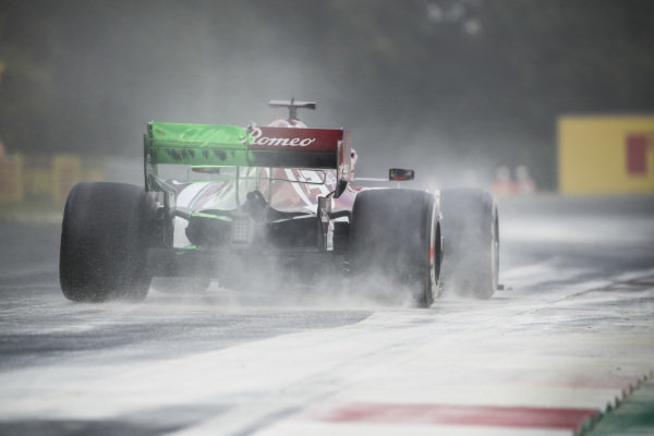 Kimi Raikkonen, Alfa Romeo Racing C38, kicks up cement dust which was laid down to cover a heavy oil spill in the F2 race prior to the session