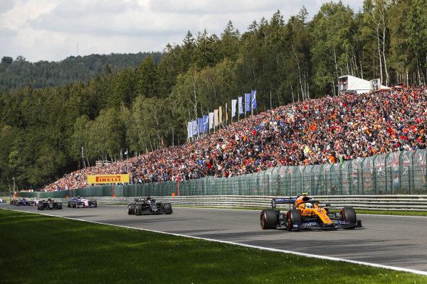 Lando Norris, McLaren MCL34, leads Romain Grosjean, Haas VF-19