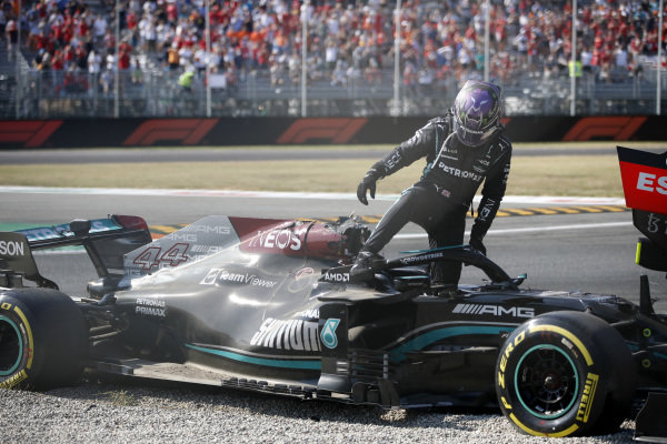 Sir Lewis Hamilton, Mercedes, climbs out of his car after crashing out with Max Verstappen, Red Bull Racing