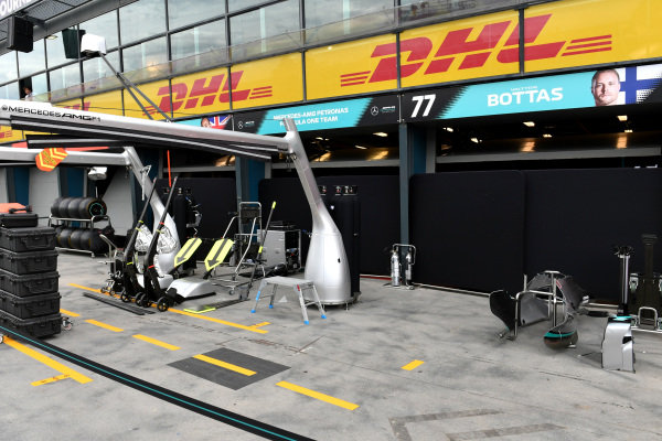 Equipment is packed away outside the Mercedes garage