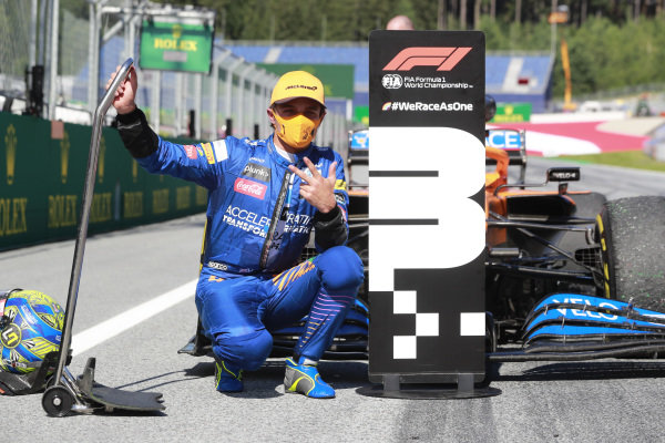 Lando Norris, McLaren, celebrates after taking a podium finish