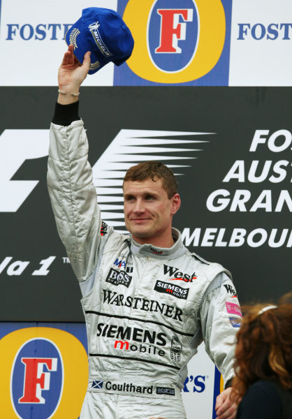 2003 Australian Grand Prix - Sunday Race,Albert Park, Melbourne, Australia.9th March 2003.David Coulthard, Team McLaren Mercedes MP4/17D, takes first place on the podium.World Copyright LAT Photographic Digital image only
