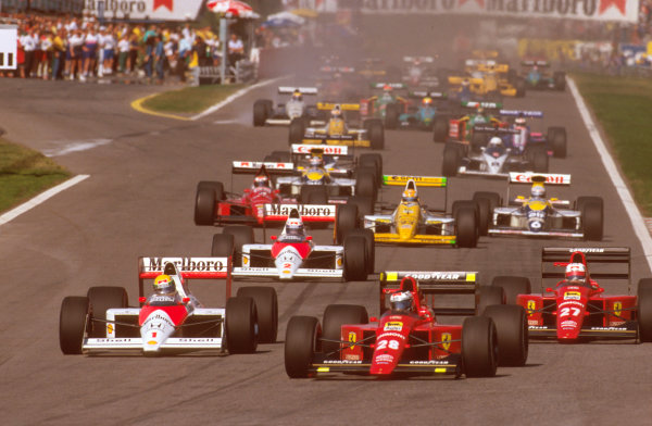 Estoril, Portugal.22-24 September 1989.Gerhard Berger (Ferrari 640) leads Ayrton Senna (McLaren MP4/5 Honda) and Nigel Mansell (Ferrari 640) into the first corner at the start, with Alain Prost (McLaren MP4/5 Honda) next up.Ref-89 POR 17.World Copyright - LAT Photographic