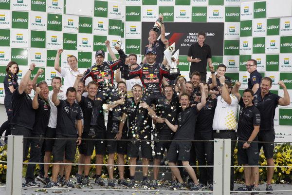The Red Bull team celebrates on the podium.