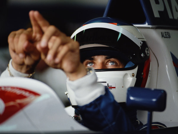 Jean Alesi, Tyrrell, signals with his hands in cockpit during practice.