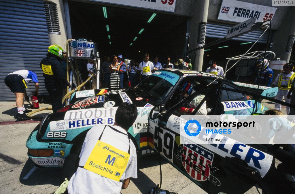 Cor Euser / Patrick Huisman / Matjaz Tomlje, Konrad Motorsport, Porsche 911 Carrera RSR, makes a pitstop.
